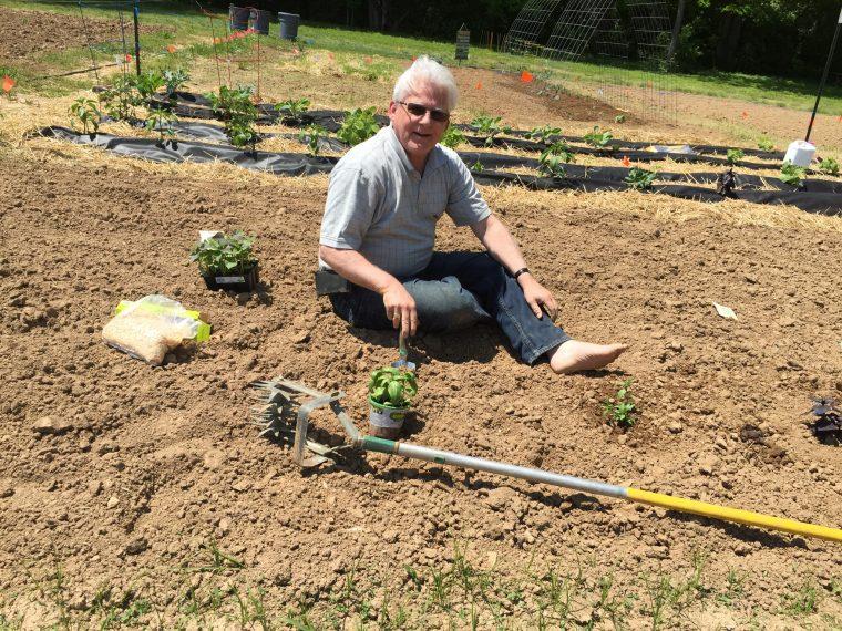 Steve planting his garden